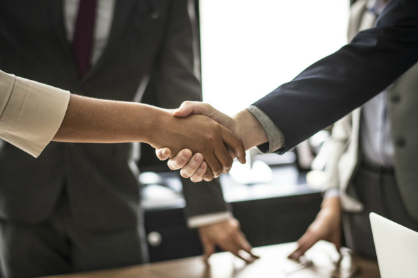 Man and woman shaking hands after successful dispute resolution