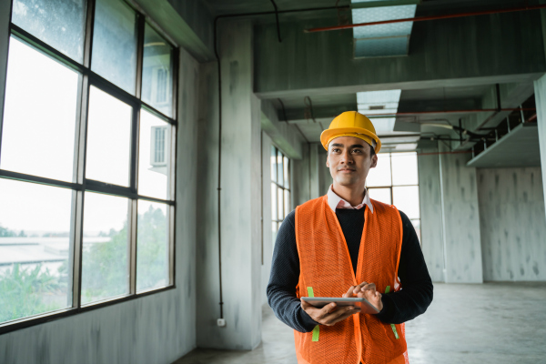 Licensed professional engineer inspecting a building site
