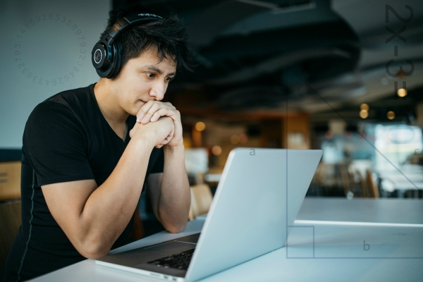 Man wearing headphones, working on a laptop, with mathematical formulas overlaid on top