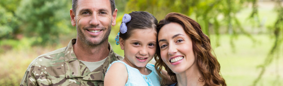 Smiling military man with his family