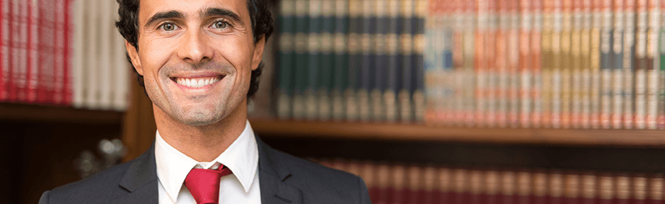 Smiling paralegal in a law library