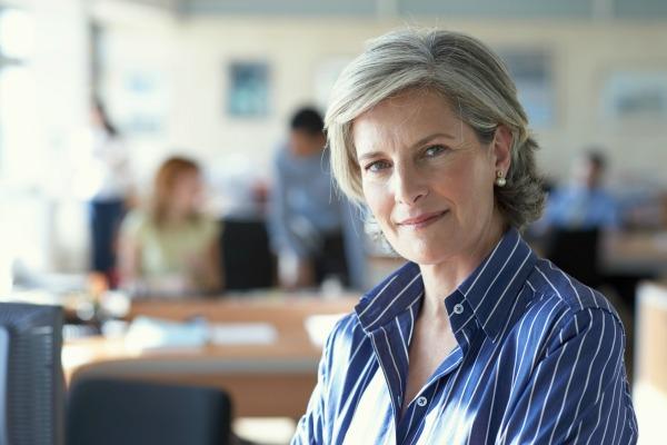 Smiling confident female leader