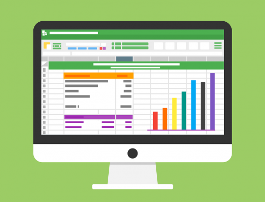 Computer screen showing spreadsheets, charts and graphs