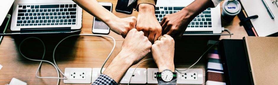 Five hands fist-bumping