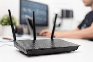 Man working on wireless network equipment