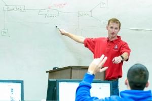 Network+ instructor explaining basic networking concepts