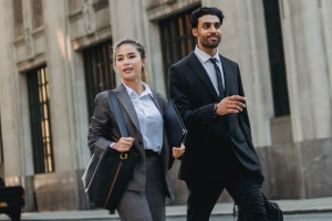 Paralegal and attorney walking down the street