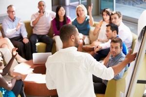 Man facilitating meeting