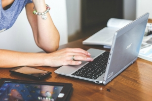 Female computer support specialist working on a laptop