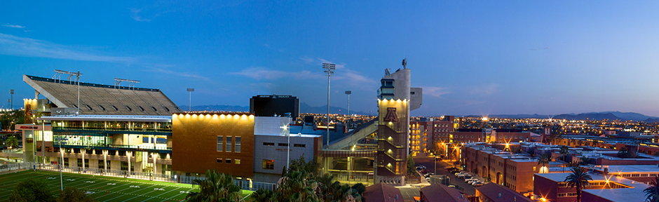 The Lowell-Stevens Football Facility, Arizona Stadium, and the Highland District dorms at dusk