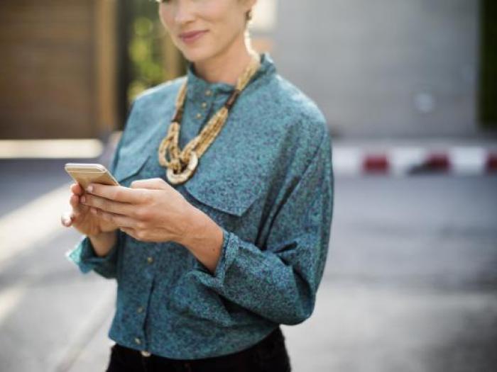 Smiling legal secretary on the phone