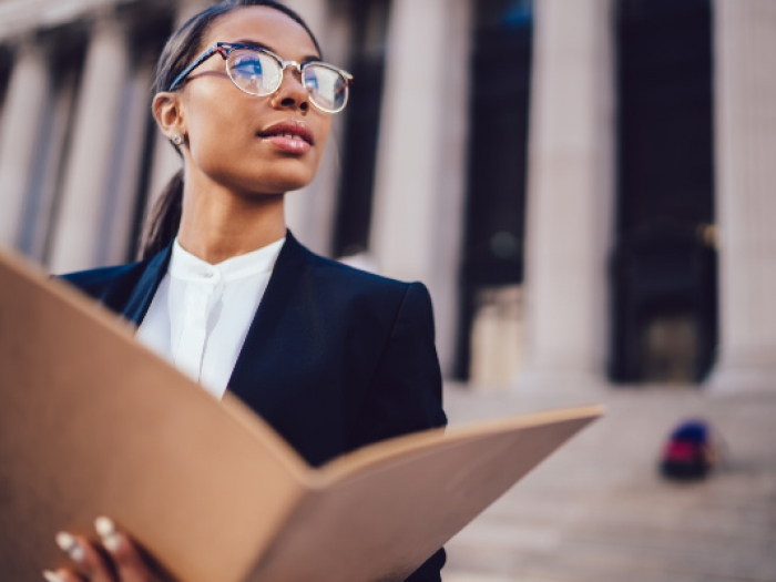 Paralegal standing in front of a courthouse